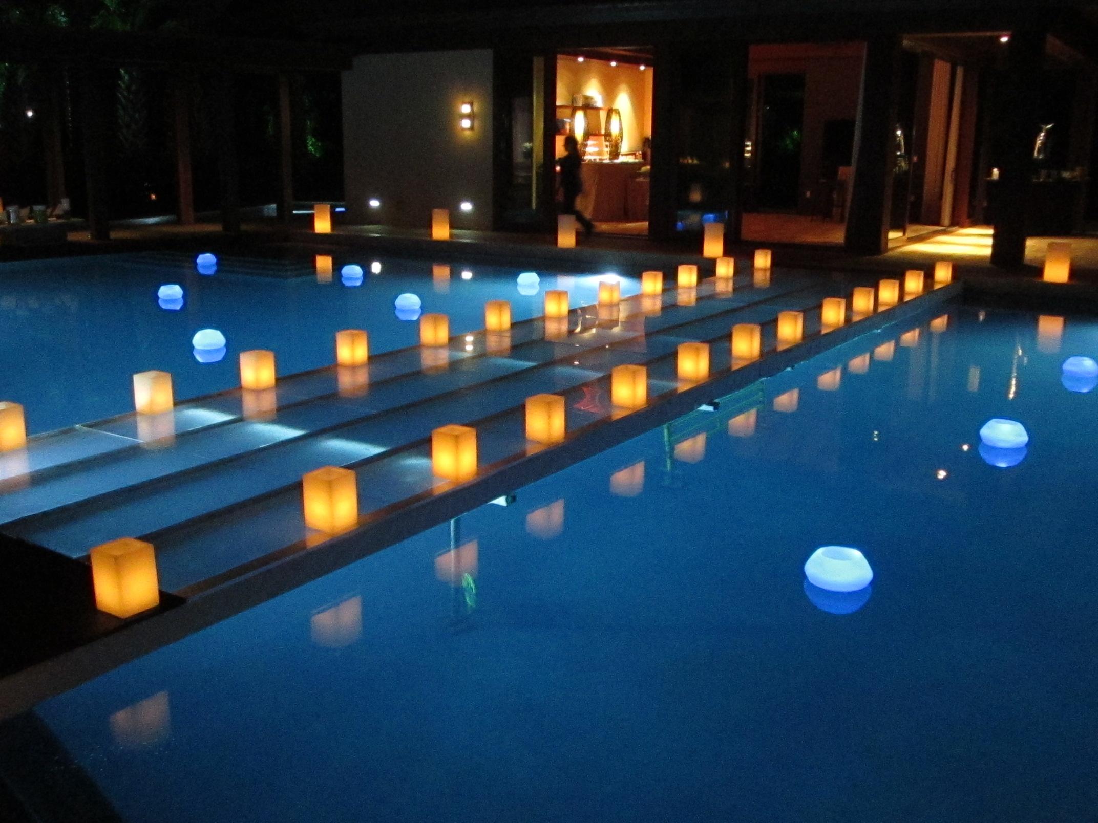 Bridge over the pool with candles