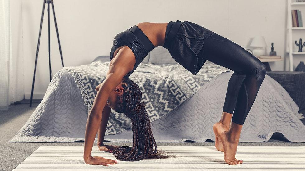 Black-woman-posting-doing-yoga.jpg