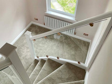 Glass staircase with rose gold fixing clamps