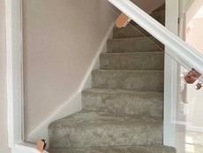 Modern glass staircase with rose gold clamps