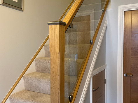 Glass and oak banisters for stairs