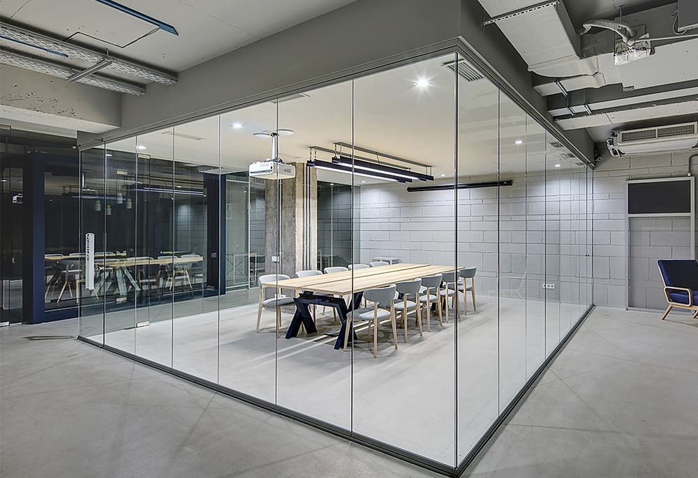 modern office with frameless glass partitions