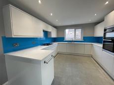 Blue painted glass splashbacks for kitchens