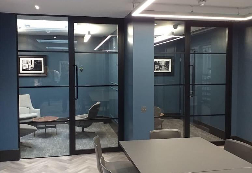 modern office with black steel-framed glass partitions
