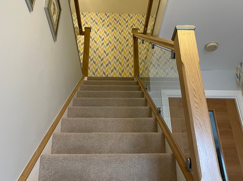 Glass balustrade with oak banister and posts