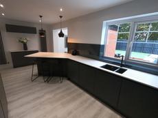 Black glass splashbacks for monochrome kitchen