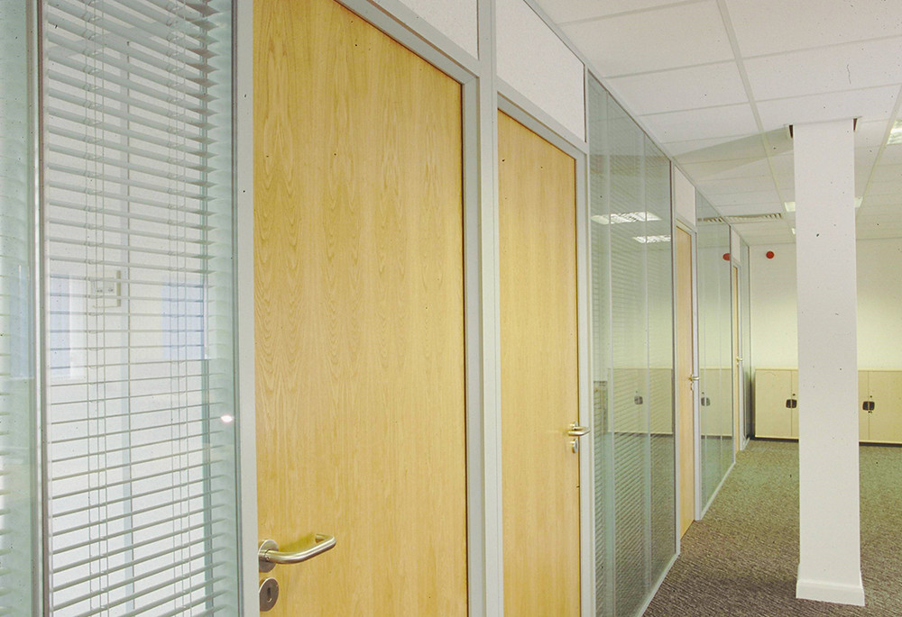 modern office with integral blinds in glass wall partitions