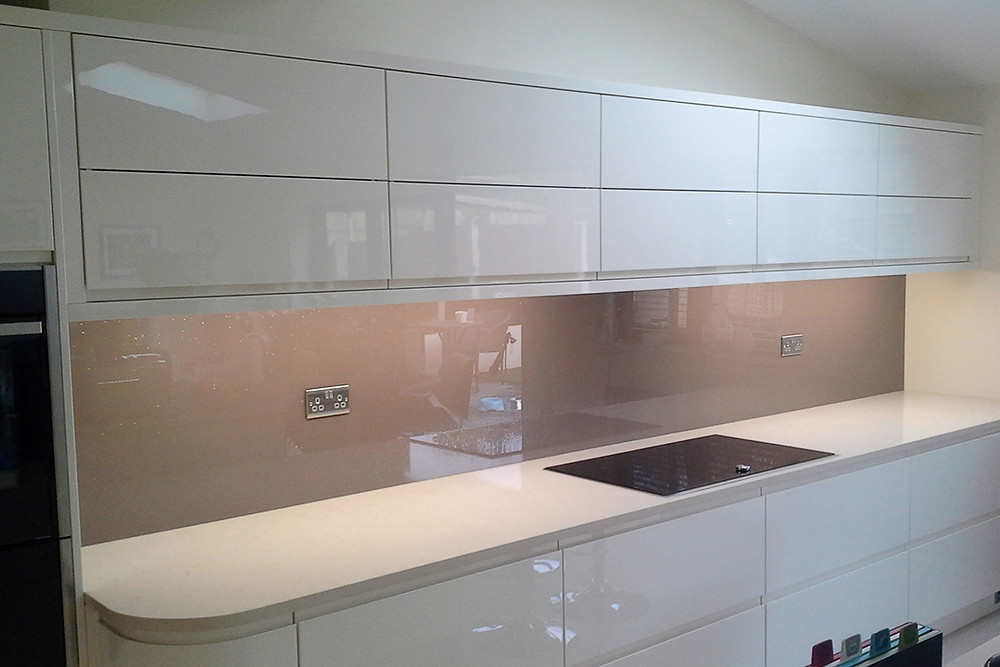 Modern kitchen with glass splashbacks for a neutral colour scheme