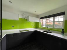Modern glass splashback in bright lime green