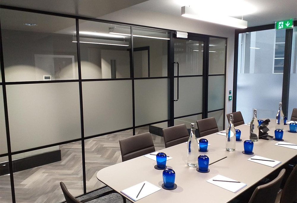 modern office with black-framed glass partitions