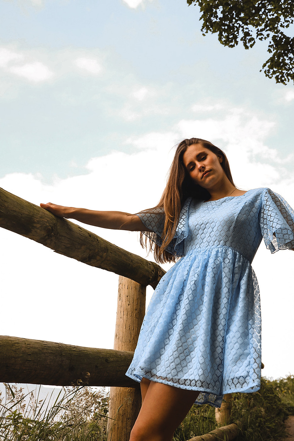 Baby blue midi dress with delicate. flutter sleeve, and full gathered skirt.