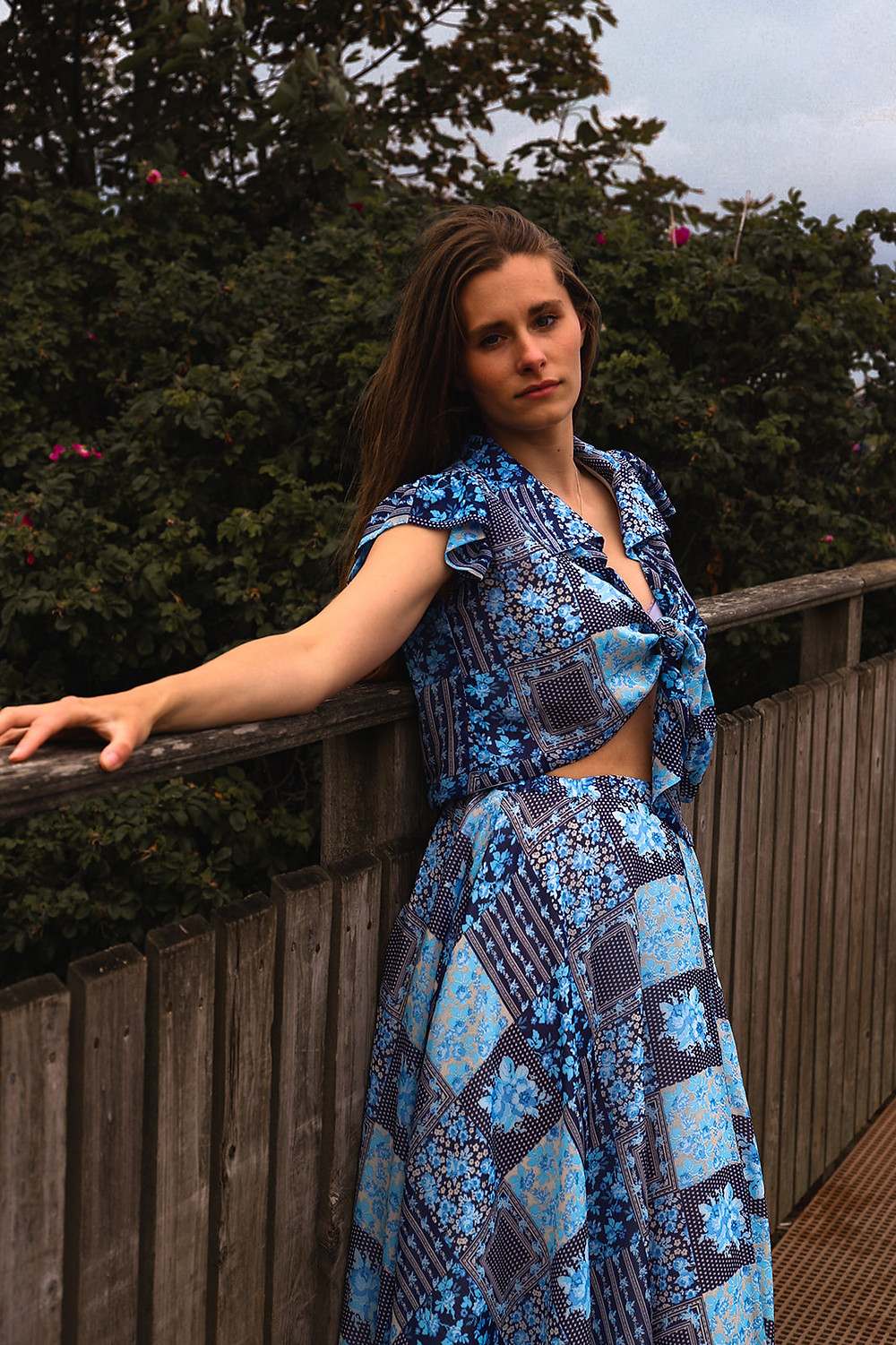 Blue handkerchief co-ord, A front tie crop top with a retro collar and ruffle cap sleeve. A mid length full flowing skirt with a high/low hemline
