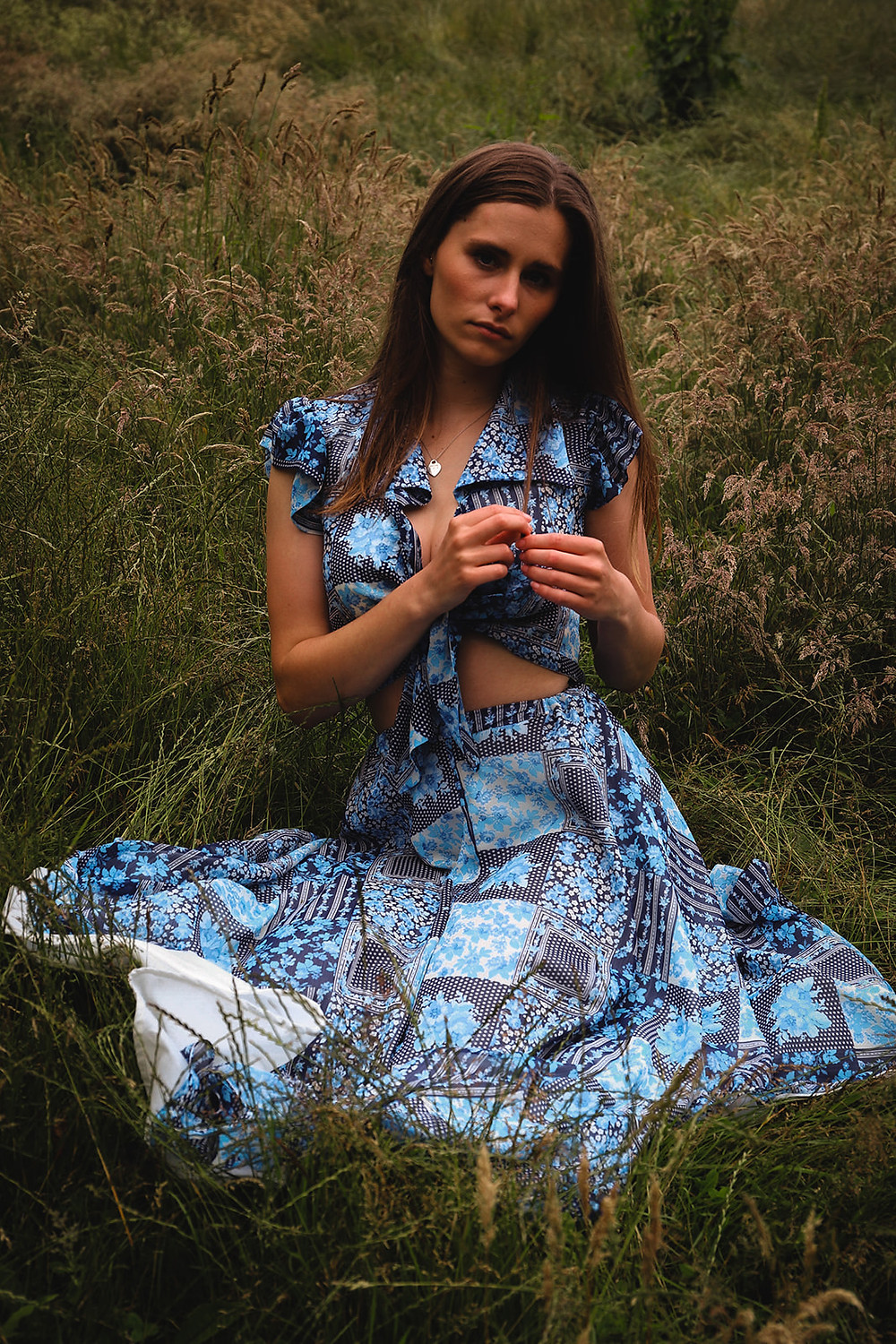 Blue print crop top with a collar and a cap sleeve. with a matching flowing midi length skirt