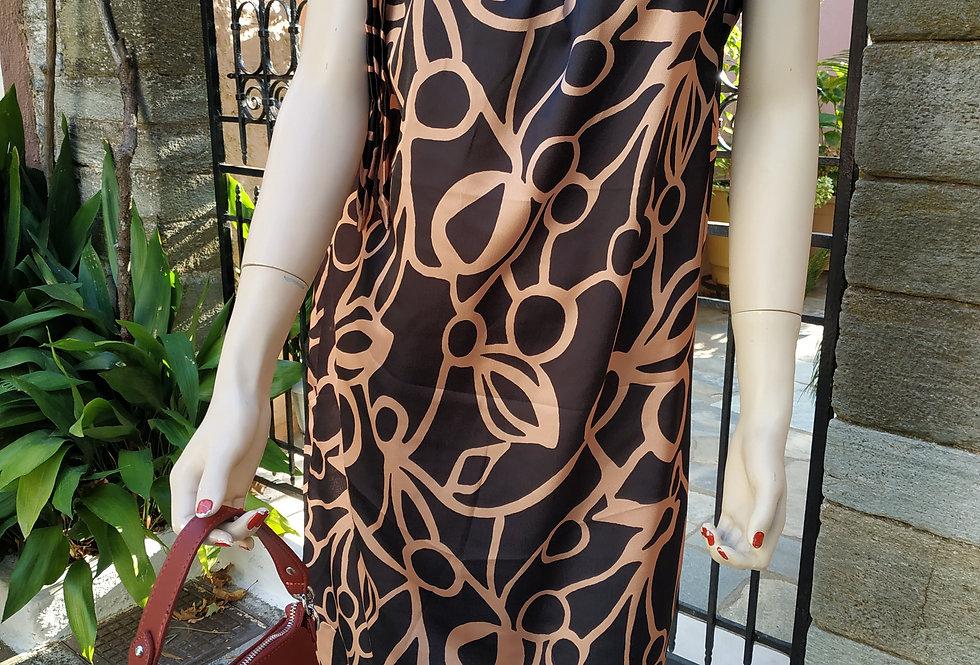 Φόρεμα midi με σχέδια χρυσό μαύρο και φιογκάκι στο πλάι.