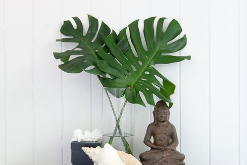 Budda Statue with Palm Fronds