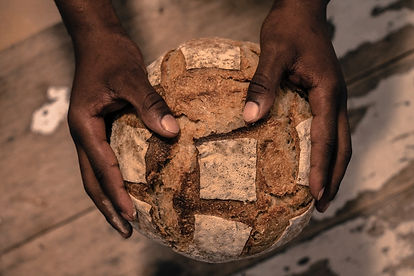 person-holding-a-bread-2601014.jpg