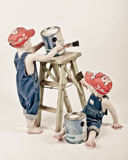 twins painting a stool