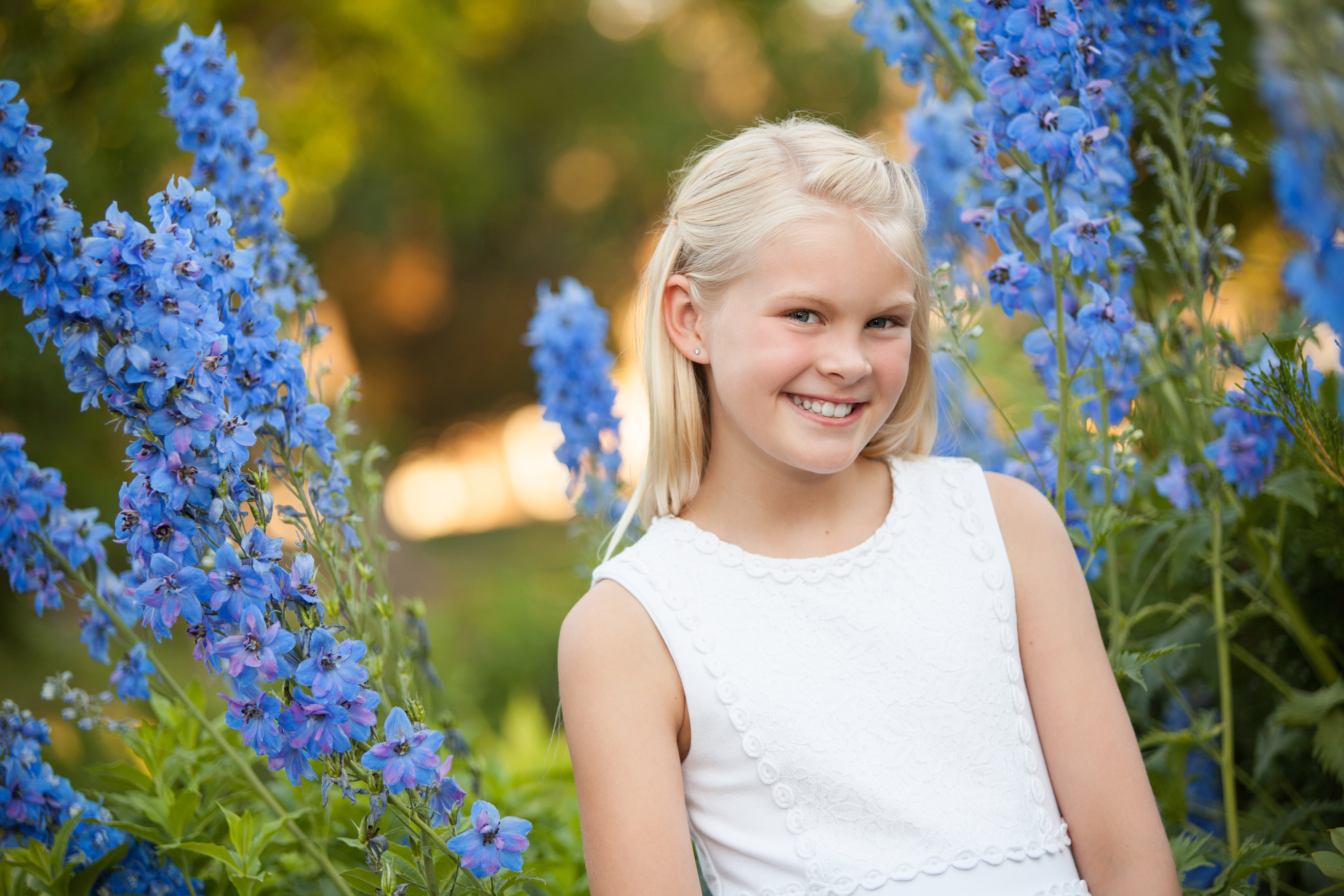 Tween girl by blue flowers