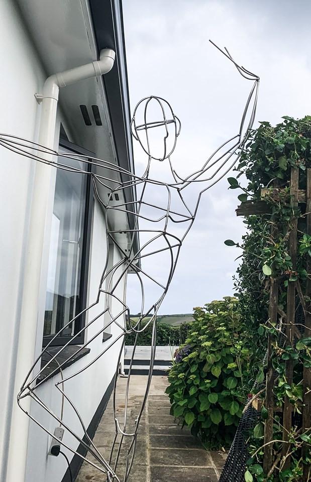 Dancing boy sculpture