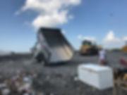 Action Junk Removal Truck full of Junk dumping at a Largo Florida Dump Landfill