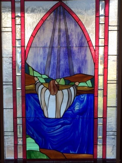 Nativity stained glass baptism