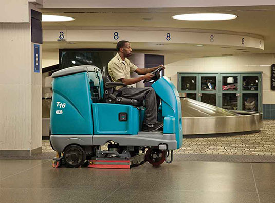 Ride on automatic floor scrubber in use