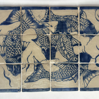 Panel of 12 stoneware tiles, £220