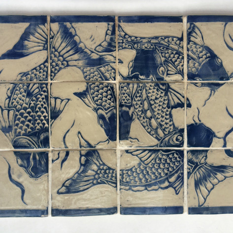 Fish swimming, tile panel