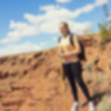 Woman Hiking in the Rugged Desert Mounta