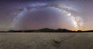Milky Way Arch over the sliding rock in racetrack playa, Death Valley National Park.jpg