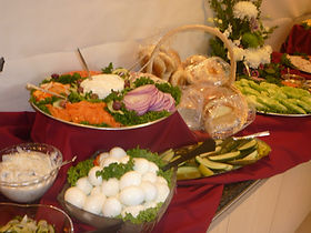 A traditional Jewish offering, including hard boiled eggs and covered mirrors