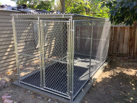 Kennel w/ rubber mats on new concrete slab.