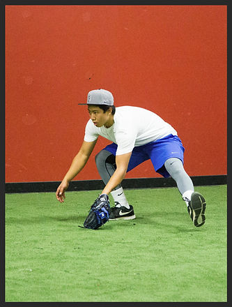 Baseball infielder catching ground ball at Hebs infield camp