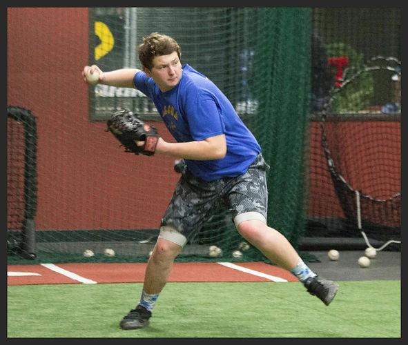 Shortstop throwing a baseball at Hebs infield camp