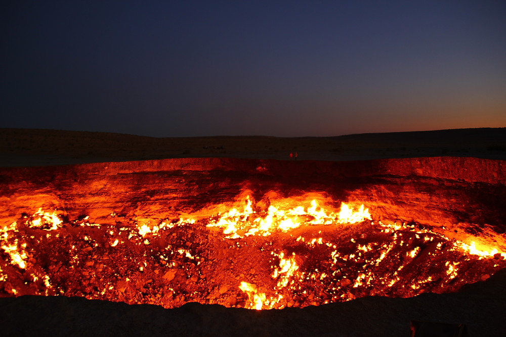 Darvaza Gas Crater. For scale, the two little specs on the other side are people.