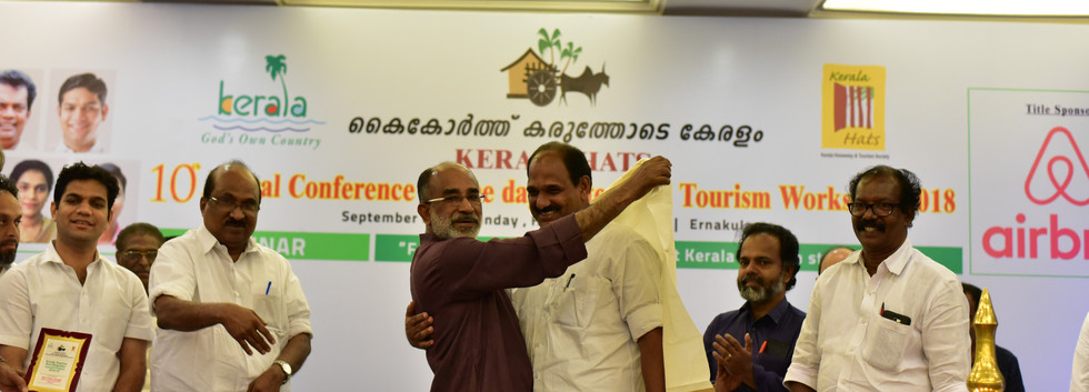 Best B&B KERALA HATS 17-18 Rosegardens Homestay Munnar Receiving the Award for the Best Homestay in Kerala