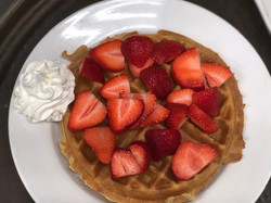 Belgian Waffle With Strawberries & Whip Cream