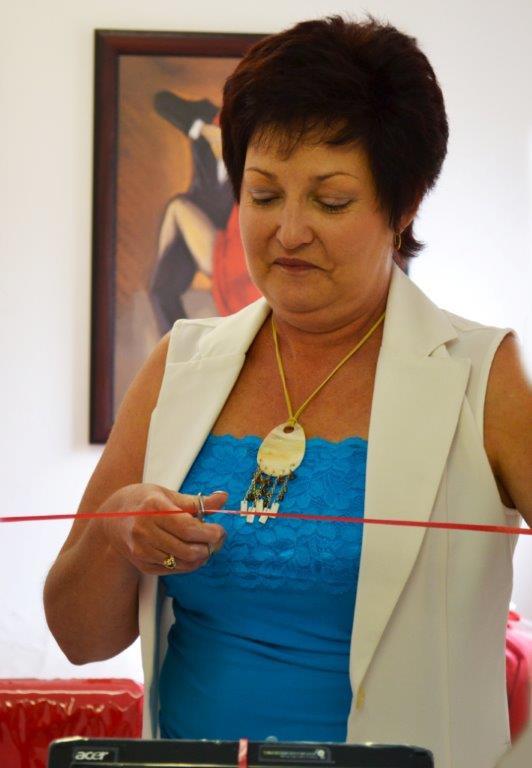 Mom cuts the ribbon