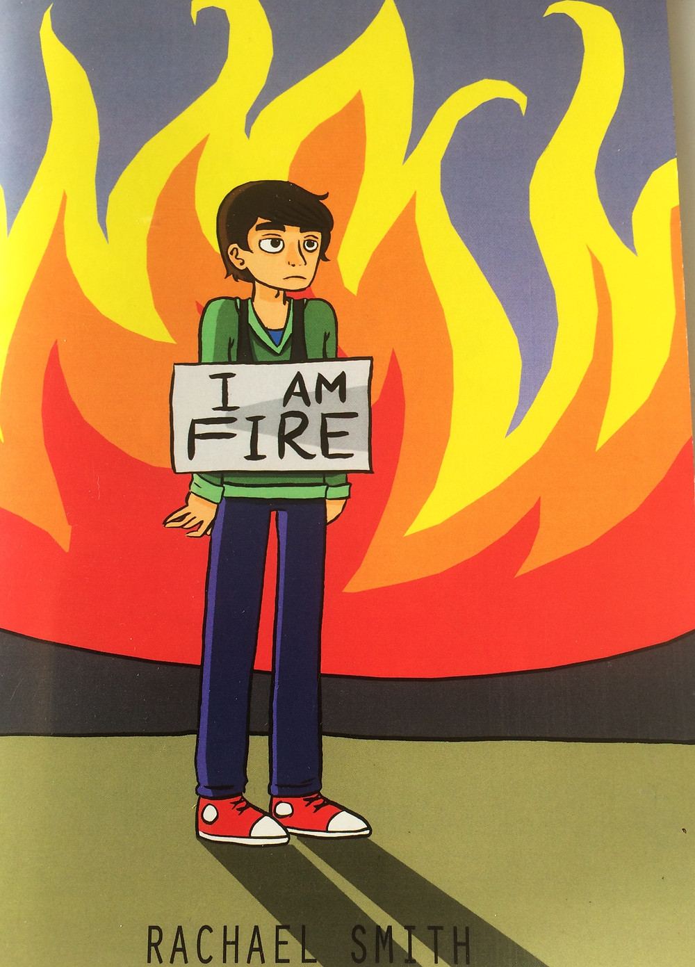book cover of I Am Fire, boy with flames behind