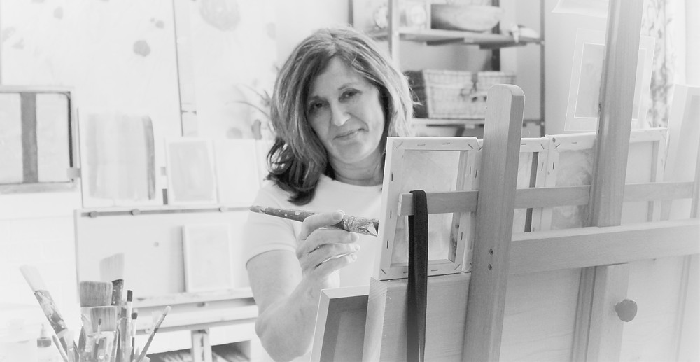 Jade, a 50-something artist in her studio, painting up a storm in her Abstract Pet London, ON Studio