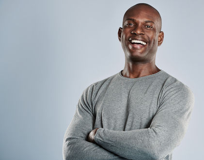 laughing-african-man-in-gray-shirt-with-