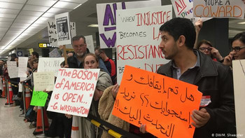 At airports across the nation, protesters and lawyers rally against Trump's travel ban