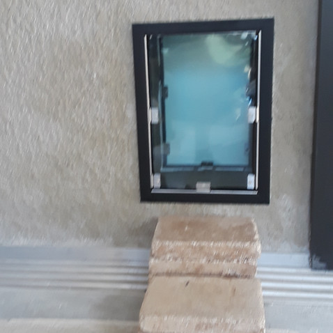 large dog door in wall outside.jpg