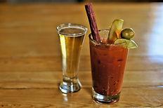 "Serving 3 versions: ""Hail Mary"" , the Baconator & Sriracha."