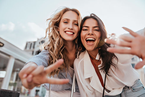 Lovable caucasian girls expressing posit