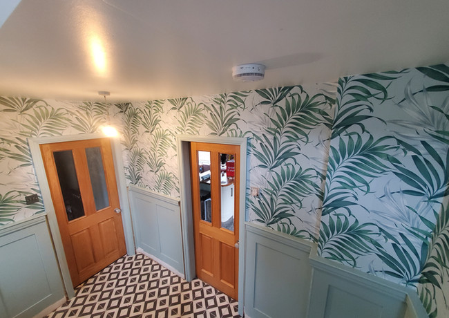 Wallpapered Hallway with oak doors