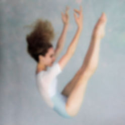 Professional ballet dancer wearing Jule Dancewear Marquise short sleeve leotard (bodysuit) featuring dot mesh cut outs and a ballet cut leg line. Dancewear a cut above!