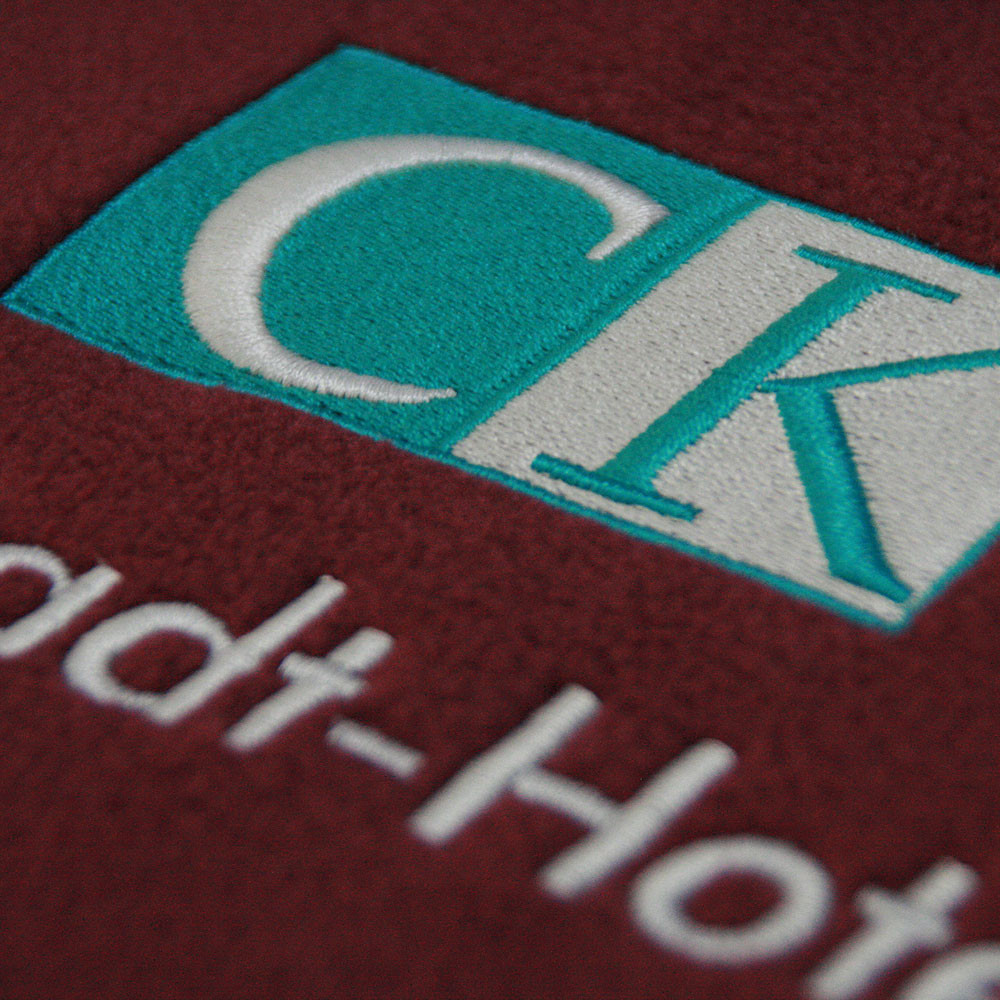 Firmenlogo CK Domstadt Hotels gestickt