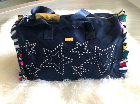 Packed Party Ruffle Duffle