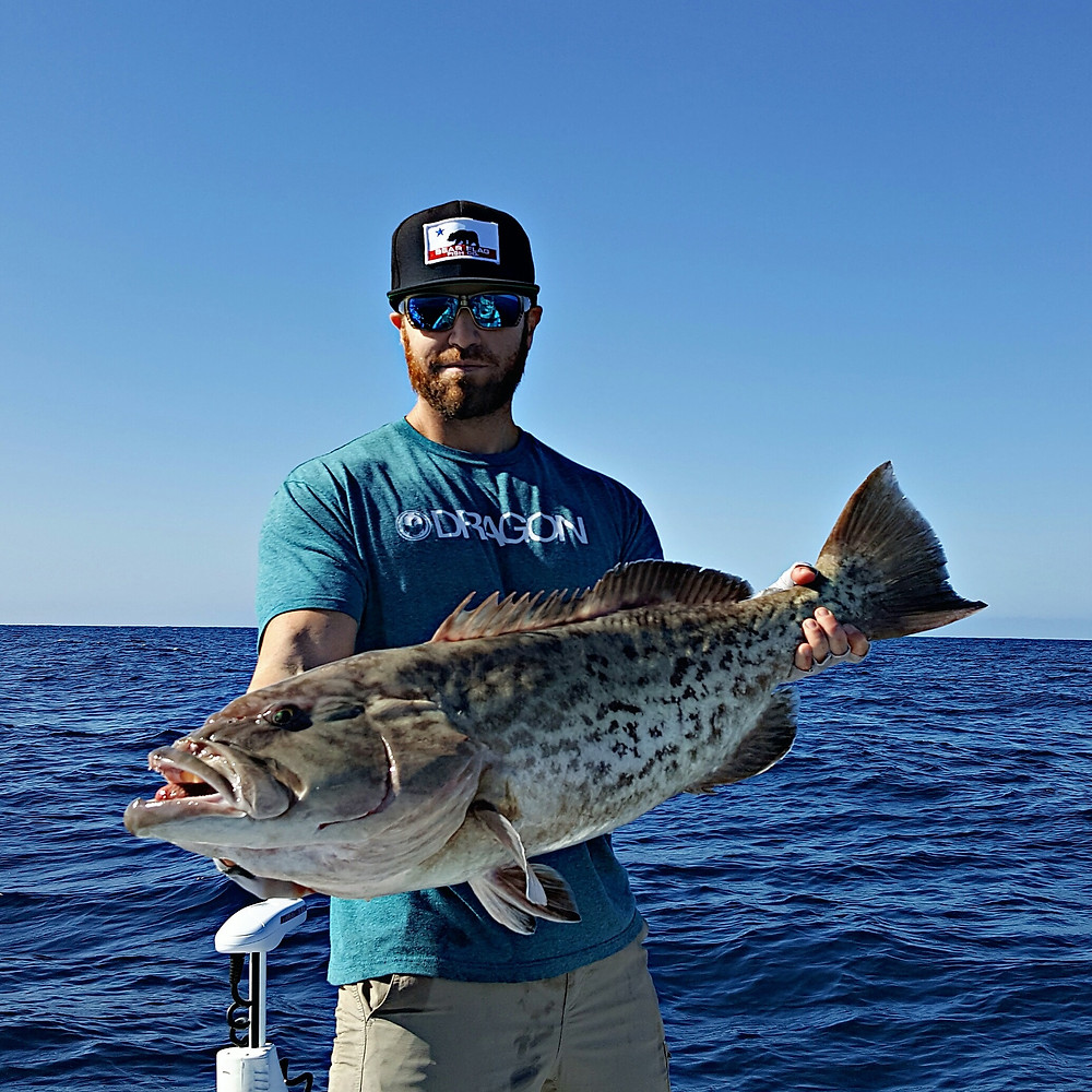 Captain Justin with a nice grouper